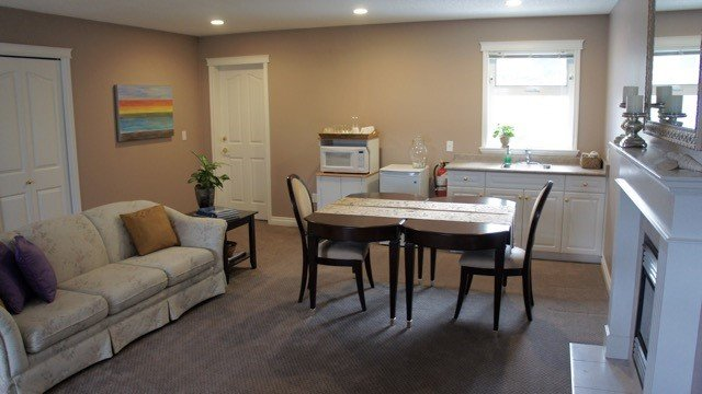 Kitchenette, table and couch in lounge area.