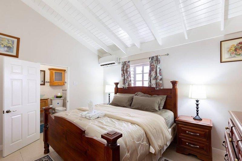King size bedroom set with ensuite bathroom.