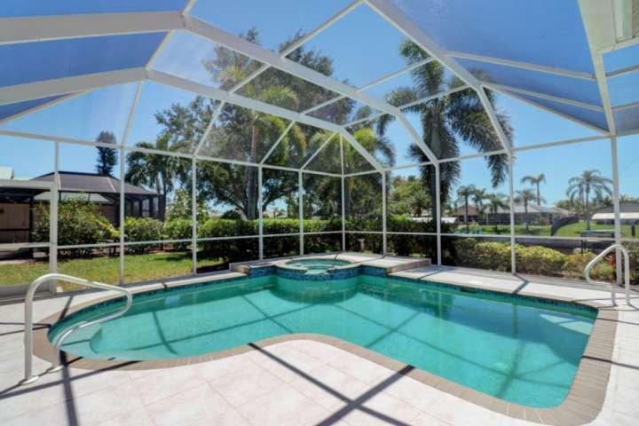 Your own tropical oasis includes a private heated pool and spa in a fully enclosed screened lanai, located on a Gulf access canal.