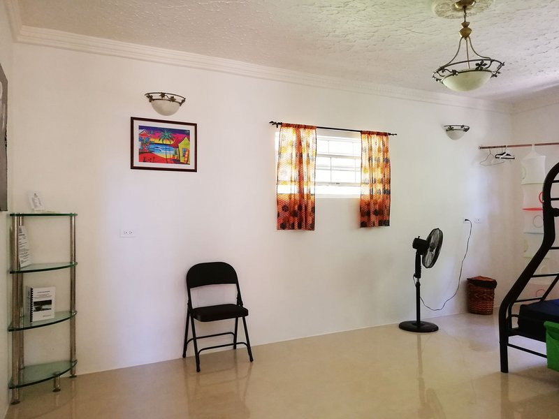 Family room with shared bathroom with hosts. Perfect for the family budget, couples, solo travellers