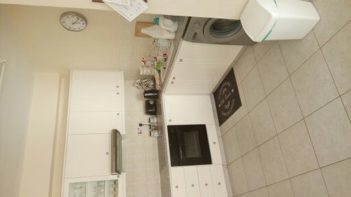 kitchen area with all white goods needed