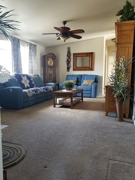 Comfy living room with 4 recliners.. 2 in each couch