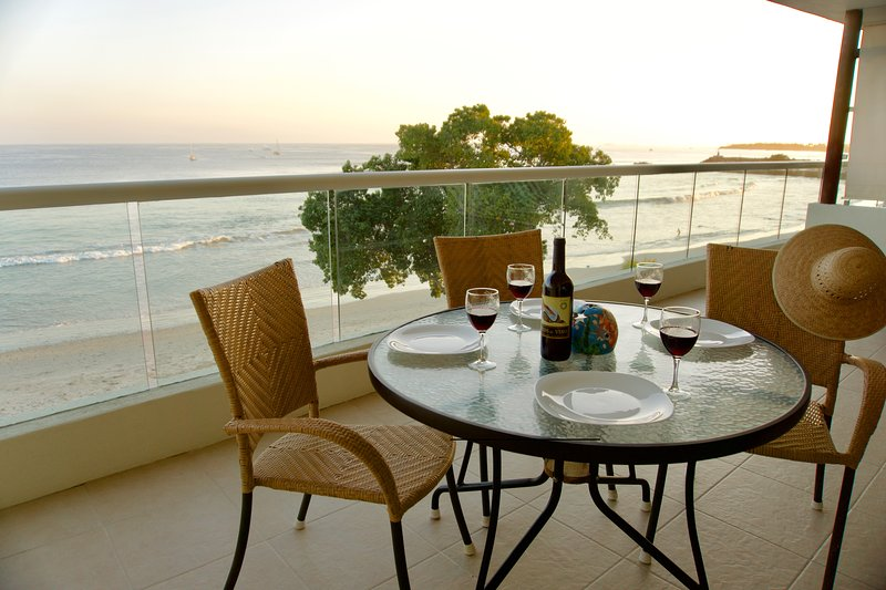 Large private balcony overlooks the ocean with sunrise to sunset views.