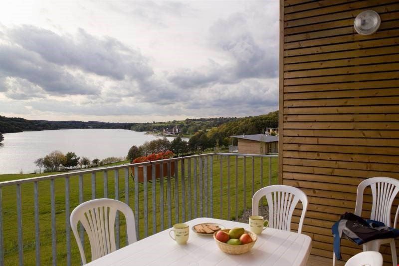 Sit out on your furnished terrace and enjoy a glass of wine in the warm sunshine.  Please note that lake views are not guaranteed.