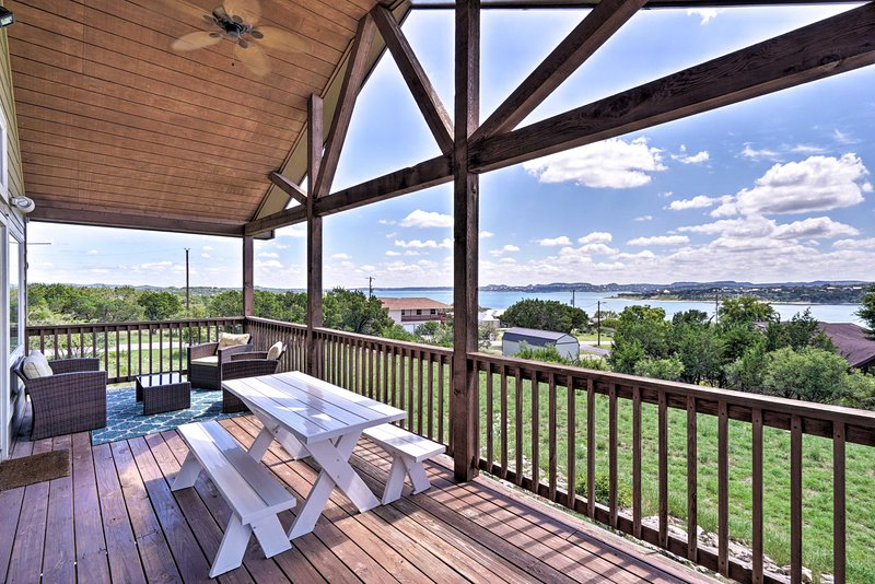 Enjoy views of Canyon Lake from your balcony at this vacation rental home.