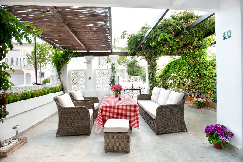 Patio area with external shower, BBQ, and dining facilities