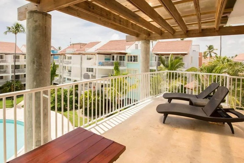 Enjoy the beautiful resort views from the spacious balcony with lounge beds, dining table and bbq.