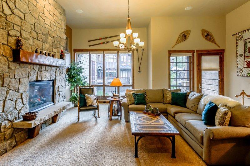Expansive windows provide abundant natural lighting to the main level