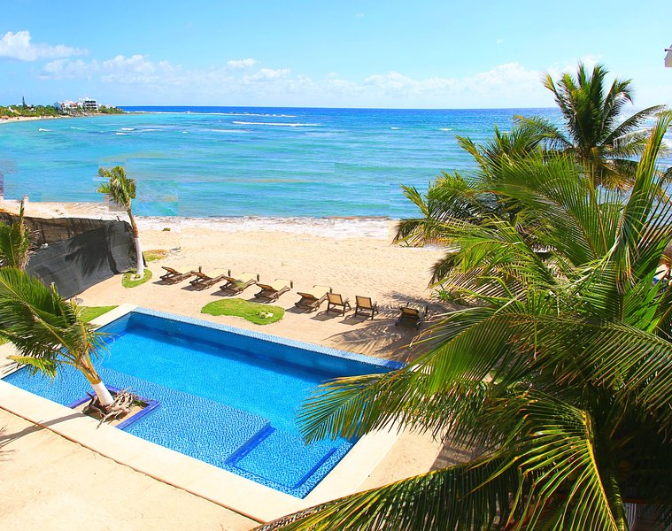 The pool is beachfront, and has seating in the refreshing water...