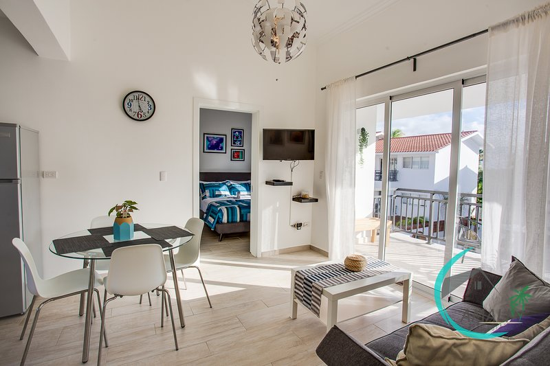 Lovely living room, dining area, balcony overlooking the residential pool!