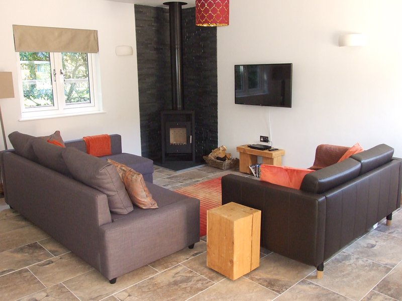 Comfortable sofas in front of the fire, perfect for those dark cold nights.