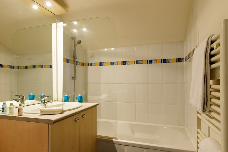 Get ready for the day ahead in the bright bathroom.
