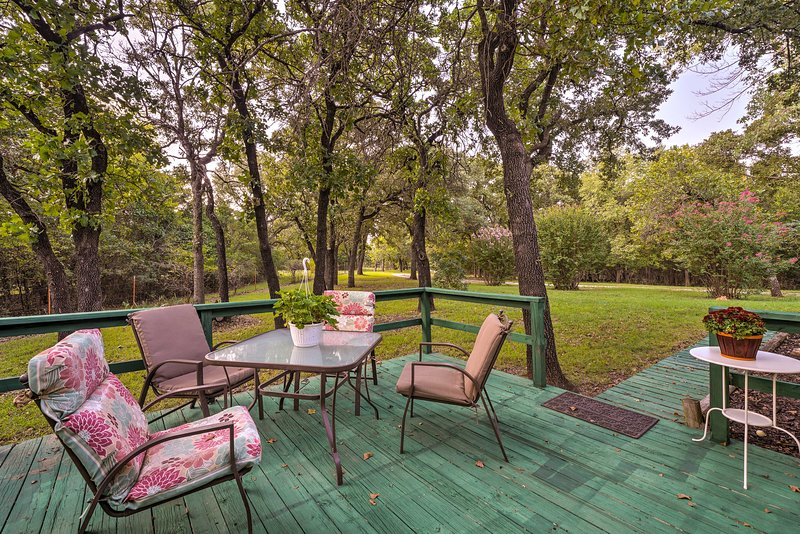 This lovely vacation rental home sits on a 10-acre property in central Oklahoma.