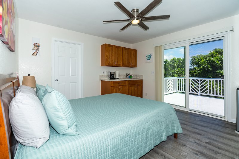 1 bedroom, 1 bath with queen bed, full wet bar and private balcony.
