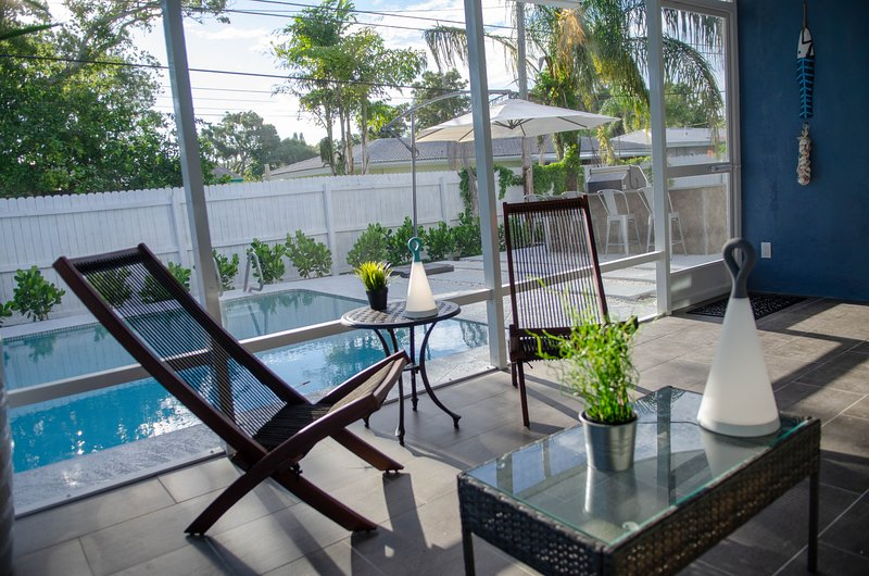 Relax in the screened-in poolside lanai