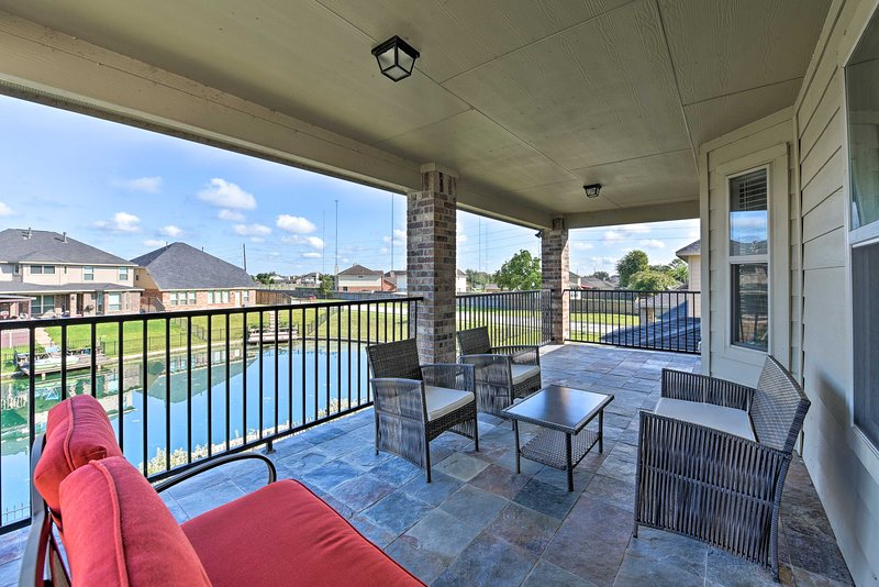 This 4-bed, 1.5-bath home features 2 terraces and a private dock.