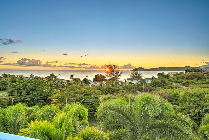 From the master room deck you have stunning sunset and Oualie Beach views!