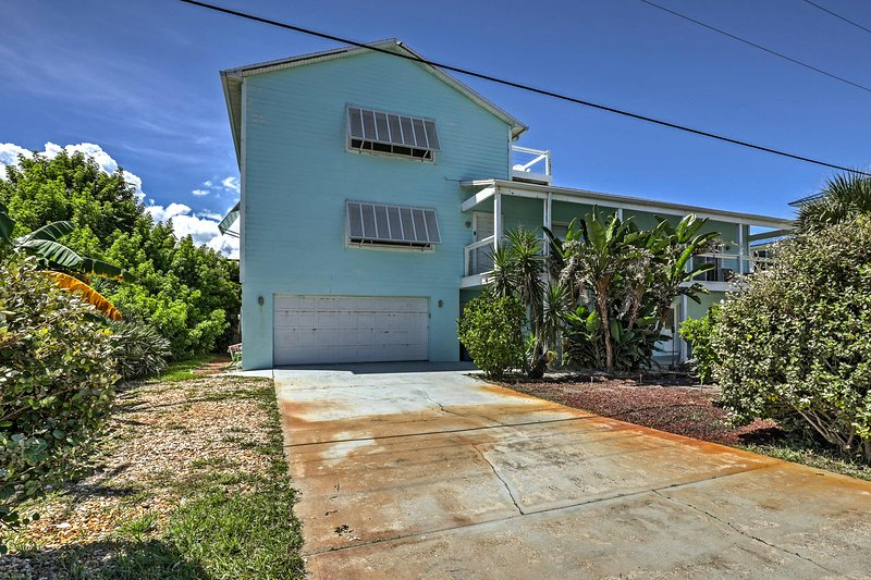 This charming home awaits your visit in New Smyrna Beach!