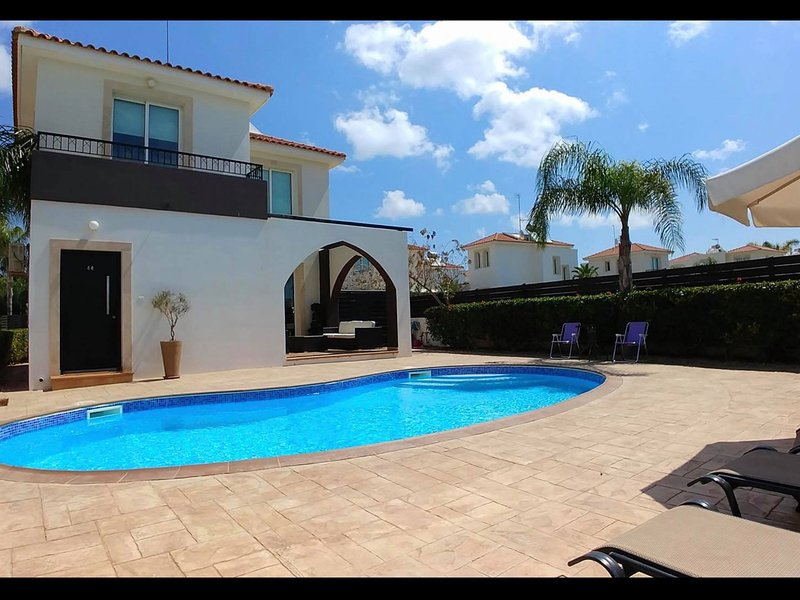 Located on a large corner plot with private pool