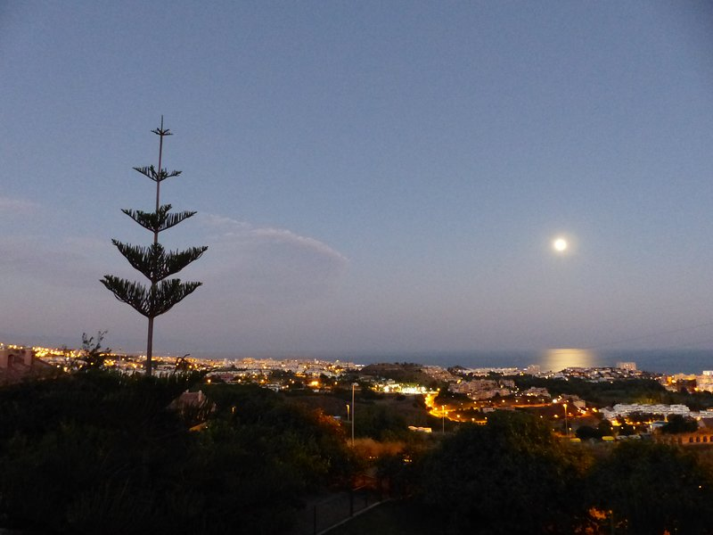 Lovely nightfall with the moon from the balcony.