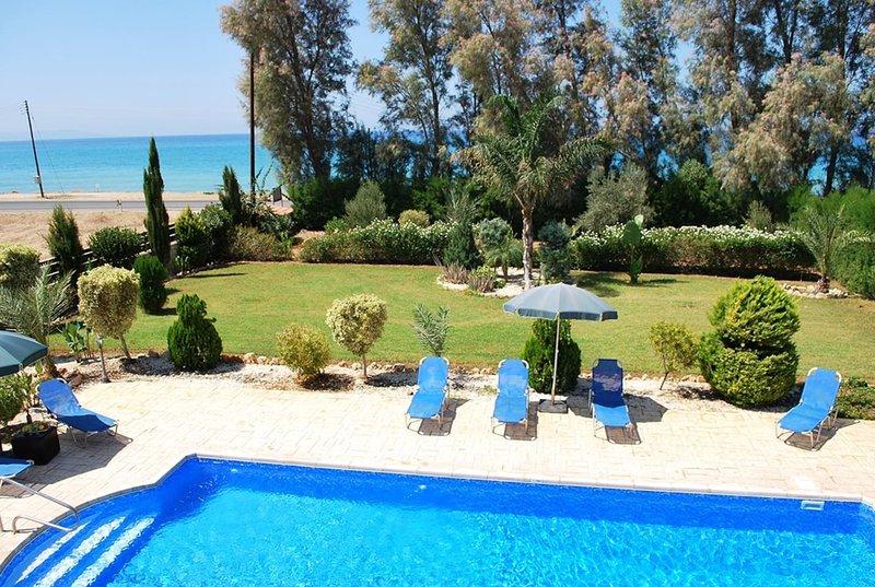 Marlin Beach Front Luxury Villa - 4 Bedrooms, holiday rental in Nea Dimmata