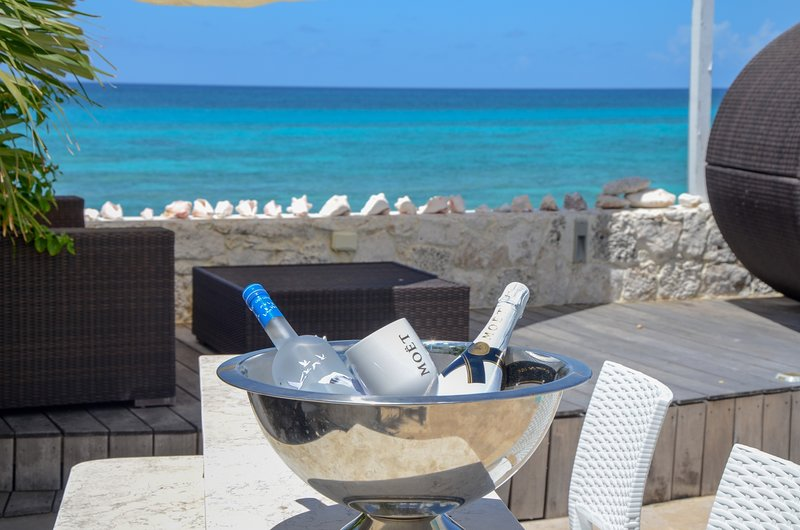 Private ocean view deck to the beach with beach bar and comfy loungers