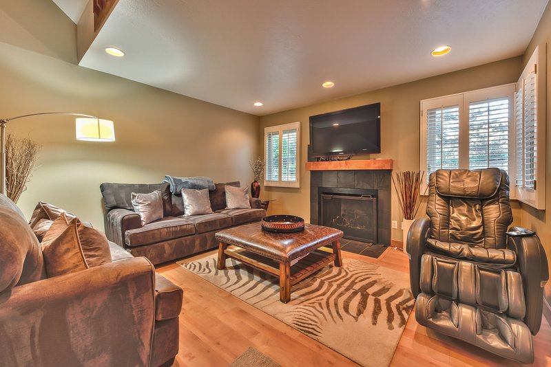 Living Room with Comfortable Furnishings, a Massage Chair, a Gas Fireplace and a 50' Samsung TV