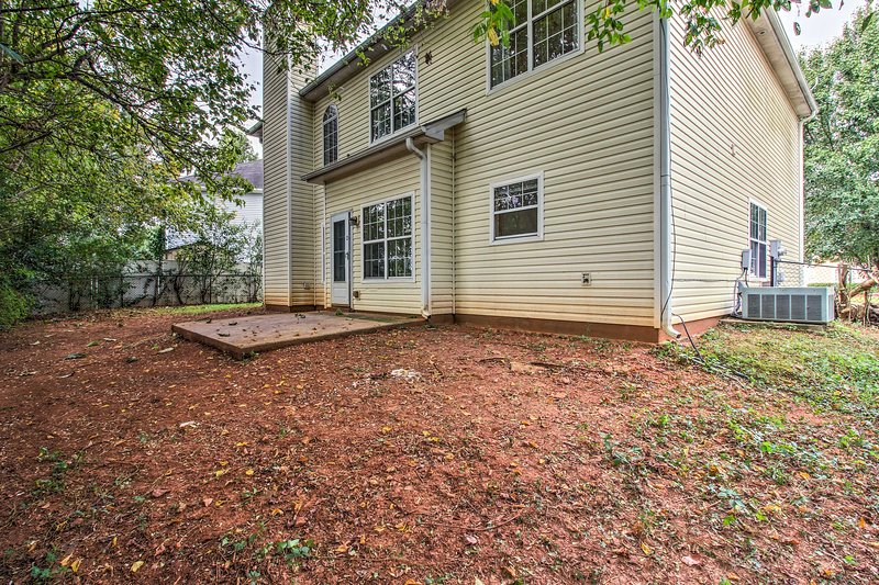 This home sits on a quiet, looped road and includes a fenced lot space.