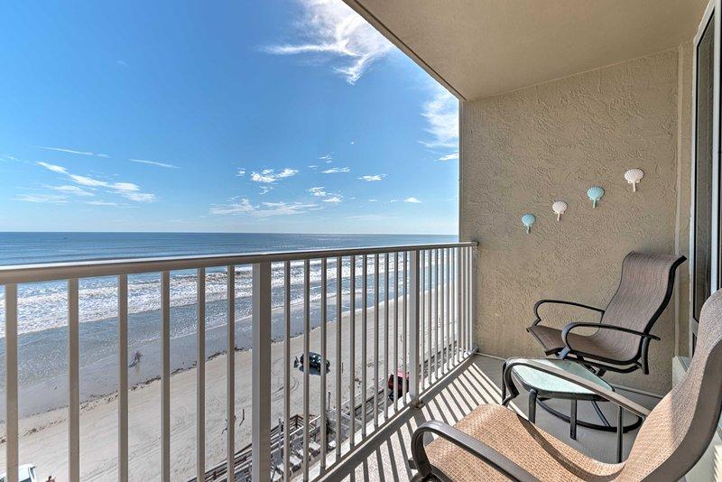 This vacation rental condo boasts a private balcony overlooking Daytona Beach!