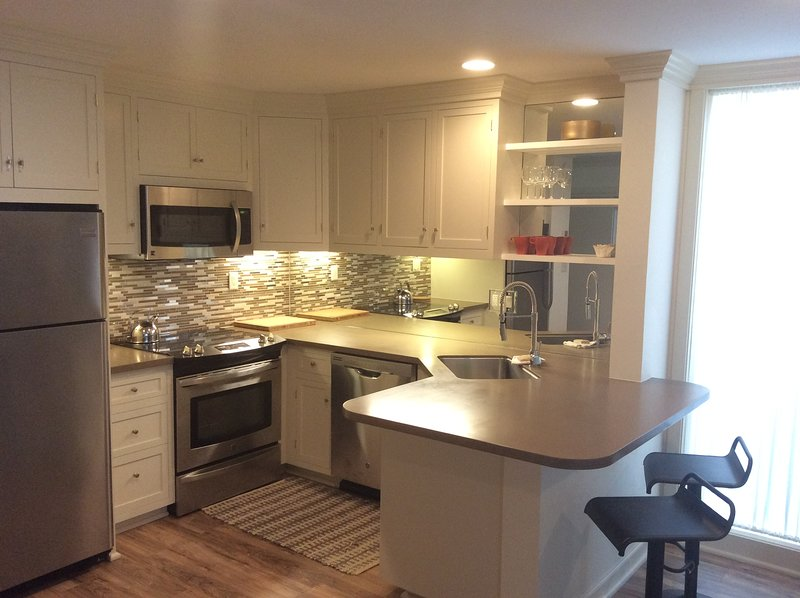 Large kitchen. Custom cabinets. Cookware/Full-service for four.