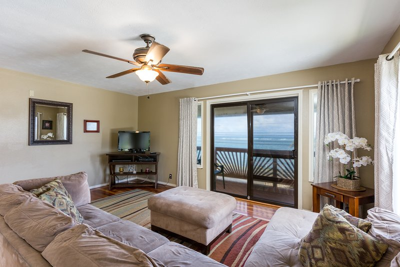 The living room is spacious and completely furnished.