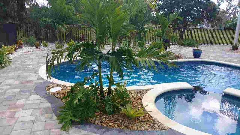Amazing heated salt water pool/spa with lush tropical landscaping & huge deck await you!
