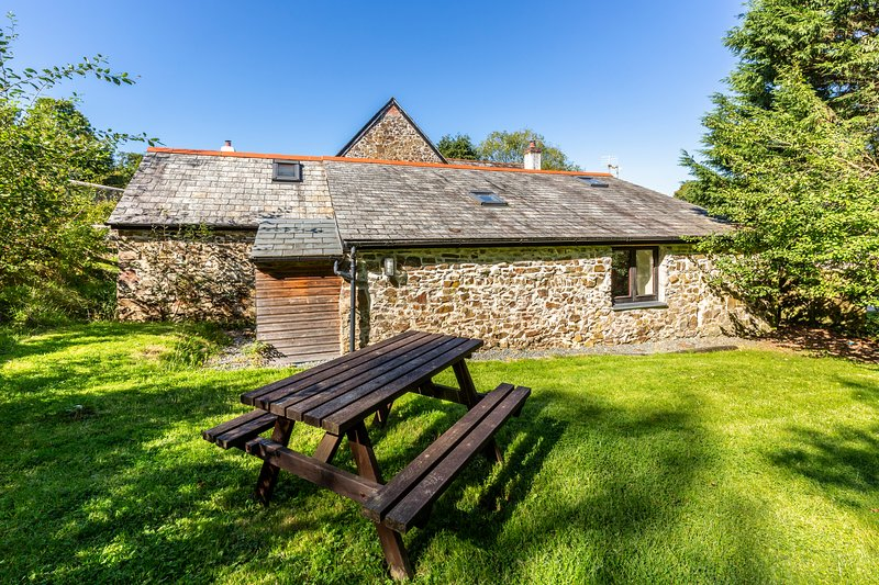 Stables cottage with an enclosed private garden, brick BBQ and private parking.