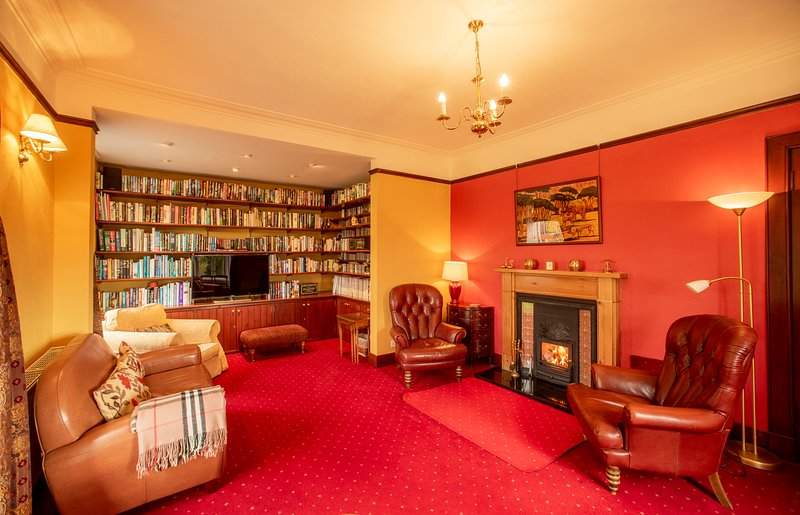 Large comfortable lounge; woodburner, library, TV, CD's DVDs, door to garden and patio
