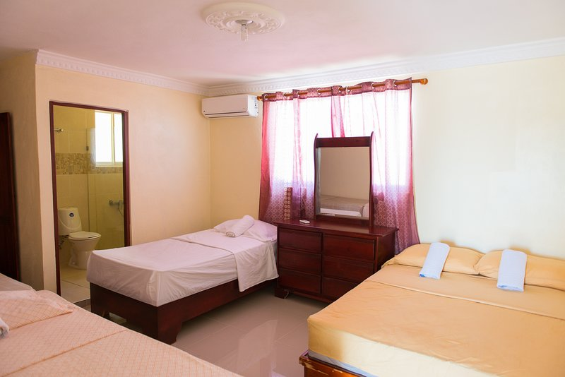 Air conditioned One Bedroom Apartment with Private Bathroom, 1 double bed and 3 single beds