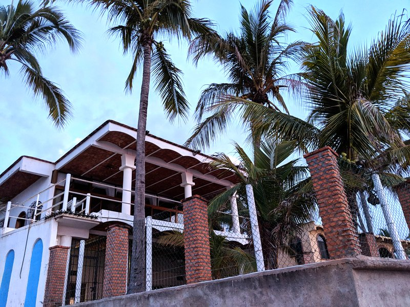 Our beach house from the beach and tidal estuary that leads to a wildlife reserve.