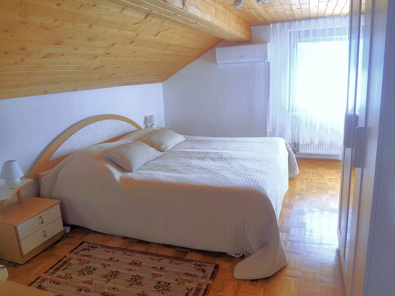 A large double bed in the bedroom.
