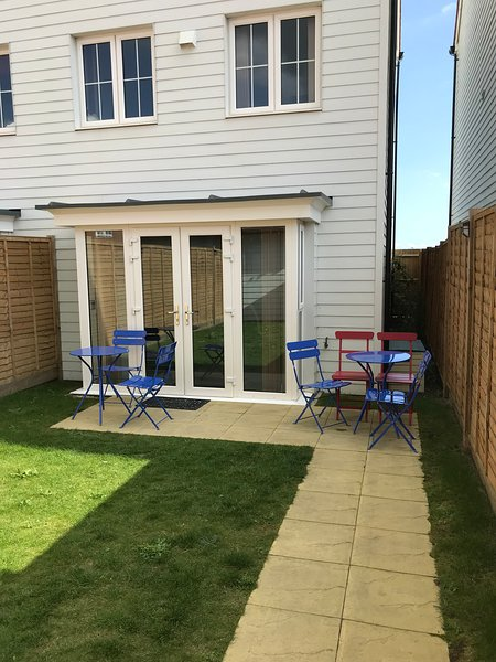 Patio and enclosed garden with table chairs