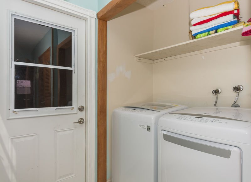 Full sized washer and dryer. and access to the garage.