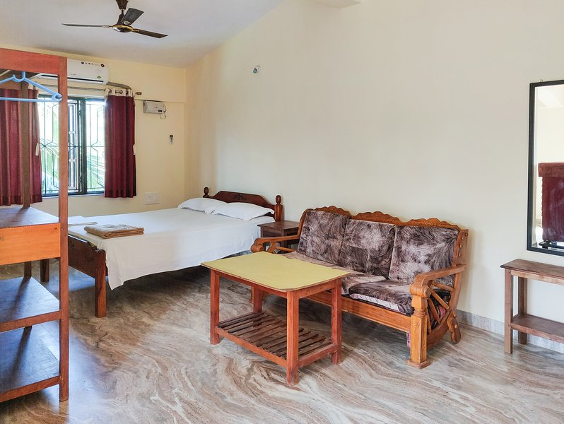 Deluxe room with double bed and separate living room