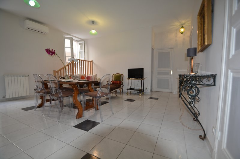 Large living room dining room with direct access to the terrace