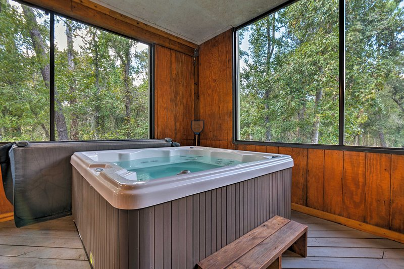 The spacious, 3,000-square-foot home features a screened-in porch with hot tub.