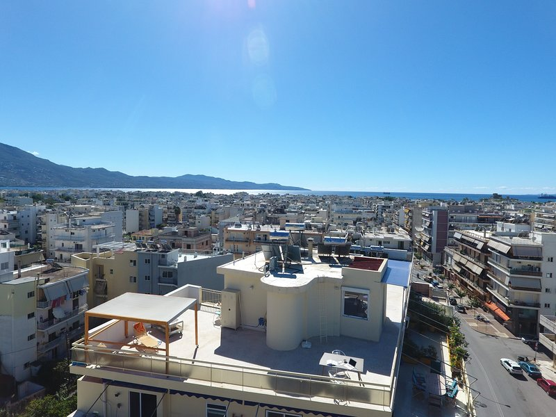 Over the roofs of the city Penthouse / ENA, holiday rental in Messini