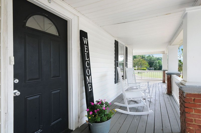 1900s Historical home with a wrap-around porch.