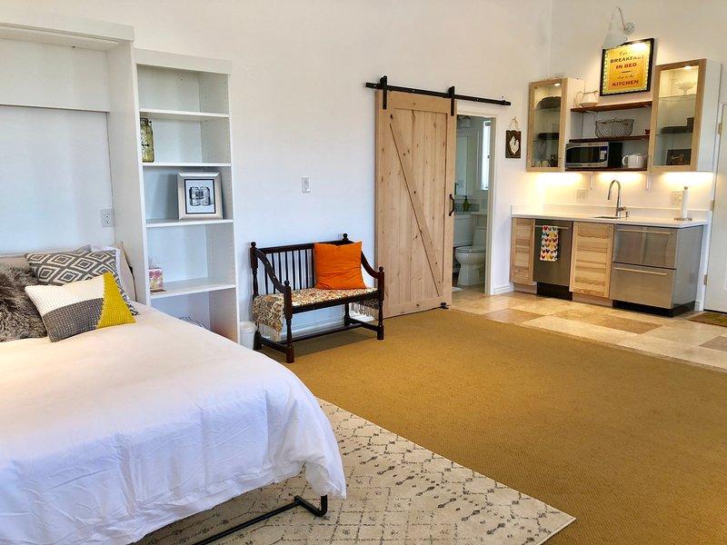 Over 1028 sqft of comfort. Brand new queen bed, kitchenette, bathroom, TV, lighting.