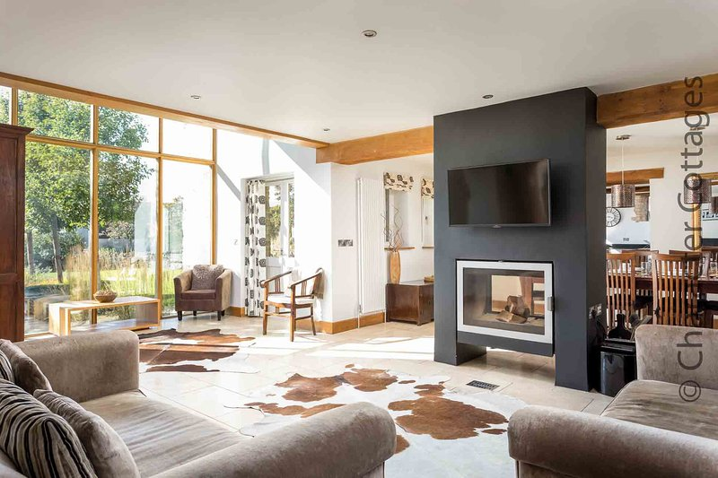 The stylish and elegant open-plan living room, with feature fireplace