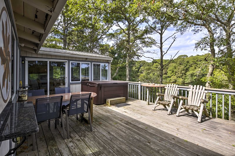 Gaze off the lakeside deck of this 4-bed, 2-bath Pocasset vacation rental home.