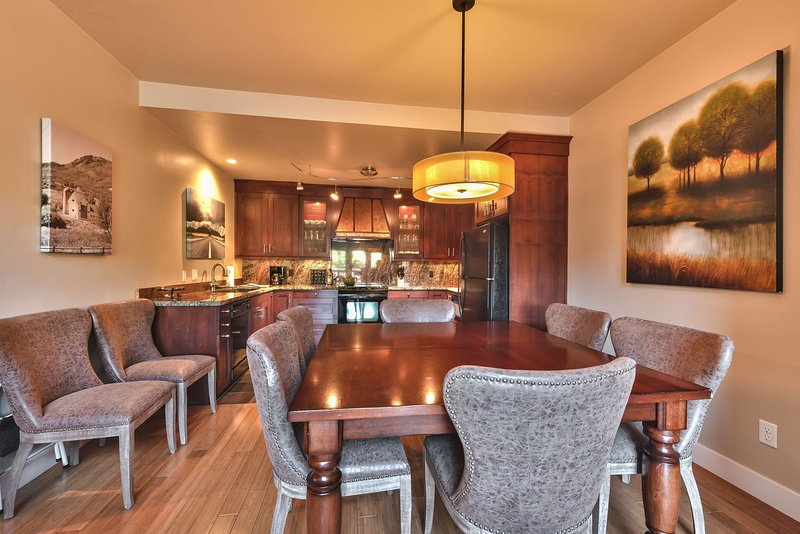 Dining Area with Dining table that seats 6.  Extra Chairs to seat 2 more.