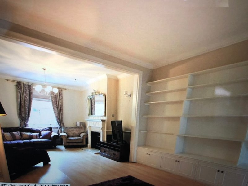 Large living area with kids playroom and traditional victorian features and a nice fireplace