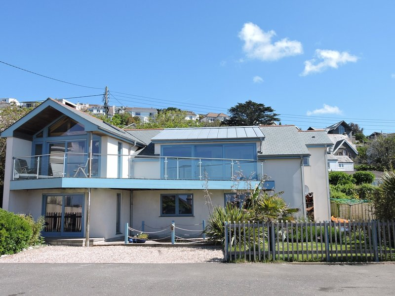With sea views,hot tub and just yards from the beach
